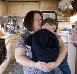"Holding it together: Pam Salter sings to son Braddock, 2, in the family's 300-square-foot trailer in Tacoma, Wash. ""Always there's this anxiety in the background,"" she says. ""It's like you're constantly in a state of emergency."""